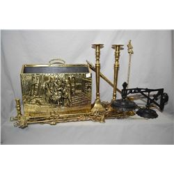 Selection of brass including bass relief magazine rack, nine vintage toasting forks, a wick trimmer,