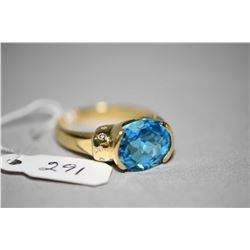 Ladies 14kt yellow gold, blue topaz and diamond ring set with 6.10ct oval faceted blue topaz gemston