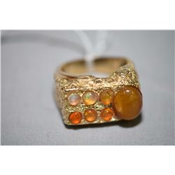 10kt yellow gold ring set with six oval shaped cabochon jelly opals and one oval shaped cabochon tig