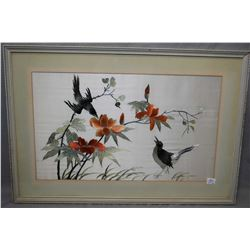 Two vintage framed Oriental needle works on silk including Peacock and birds and lotus flowers