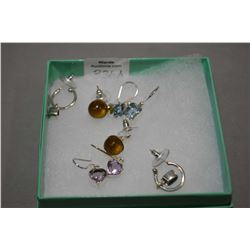 Selection of brand new sterling silver earrings including blue topaz, two pair of amethyst and a pai