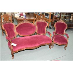 Antique two piece parlour set with handcarved oak frames including settee and open arm parlour chair