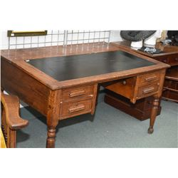 Antique oak double pedestal knee hole office desk with sloped leather wrapped writing surface