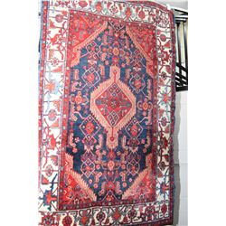 "100% wool carpet with center medallion, wide border in shades of cranberry, blue and cream, 52"" X 84"