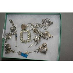 Selection of sterling silver and silverplate jewellery incuding charms, charm bracelet, brooch etc.