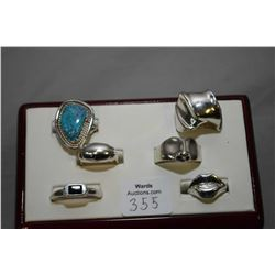 Six sterling silver artisan made rings including one set with turquiose