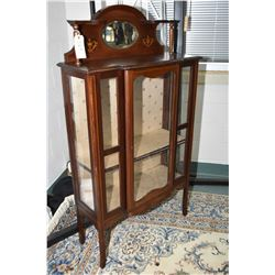 Antique Sheraton display cabinet with single center door, glass on three sides, and bevelled mirrore