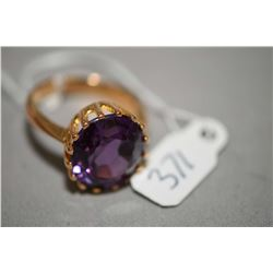 Ladies tested 20kt yellow gold ring set with one 11.76ct oval faceted synethic sapphire. Retail repl