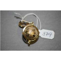 14kt yellow gold spinning globe pendant. Retail replacement value $1,500.00