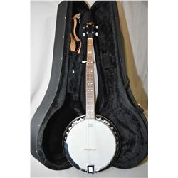 Tradition five string banjo in fitted case with a selection of banjo playing books