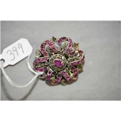 Ladies antique late Georgian period silver brooch set with 0.41ct of oval faceted pink sapphires, an
