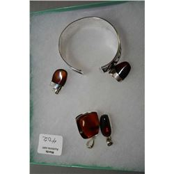 Selection of brand new sterling silver including bangle and four red cherry amber pendant