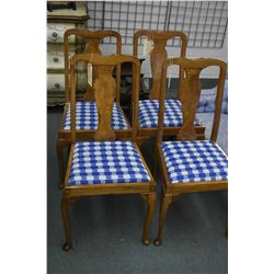 Set of four dining chairs with upholstered seats and cabriole supports