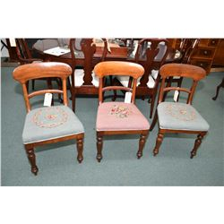 Three matching William IV mahogany side chairs, all with needlepoint upholstered seats
