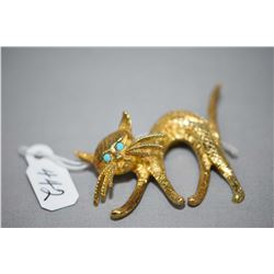 14kt yellow gold cat design brooch set with turquoise gemstone eyes. Retail replacement $2,115.00