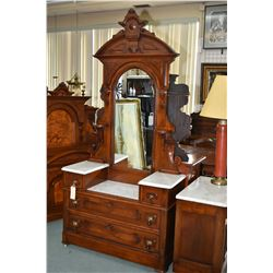 Antique Eastlake bedroom suite including a four drawer marble topped mirrored dresser, a marble top