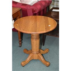 Semi-contemporary center pedestal oak occasional table