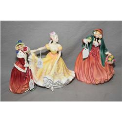 "Three Royal Doulton figurines including ""Christmas Morn"" HN1992, ""Nannette"" HN2379 and ""Lady Charmia"