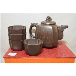 Purple clay teaset with four cups