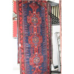 100% wool area rug with triple medallion, wide border in shades of royal blue, red with green and cr