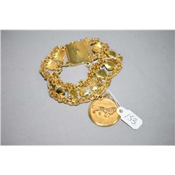 Ladies 14kt yellow gold gold and double stranded bracelet set with sea shell motif design and attach