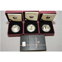 "Three Canadian Royal Mint boxed fine silver $10 coins including ""Orca"", ""Boreal Forest and lenticula"