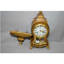 Vintage Swiss made chiming La Cassel French style clock with matching wall mount shelf, working at t