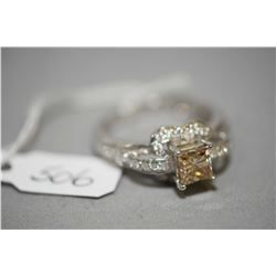 Ladies 14kt white gold and diamond ring, set with 1.00ct princess cut champagne coloured center diam