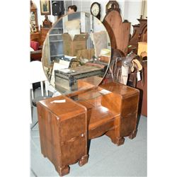 Art deco walnut drop vanity with five drawers, glass center shelf and round mirror