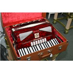 Vintage red accordion made by Noble in hard case