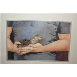 Framed original watercolour painting of a boy holding a baby duck, initialled by artist and dated '8