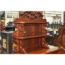 Two tier mahogany Victorian sideboard topper with carved fruit and scroll decoration, was being used