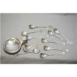 Selection of Danish silver including figural spoons, tea strainer etc