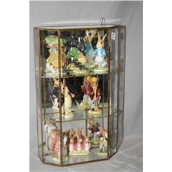 Brass and glass wall mount display with six Beatrix Potter figures and two Royal Doulton figures inc