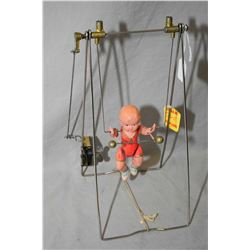 Vintage key wind acrobat toy with celluloid figure