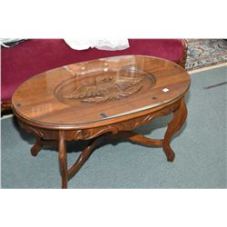 Mid 20th century walnut coffee table with decorative skirt and carved inset eagle under glass protec