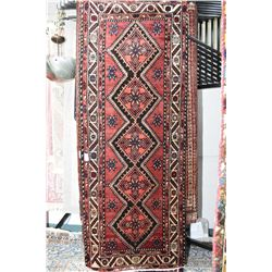 100% wool area carpet wth diamond medallions, wide multiple border, red background with blue and cre