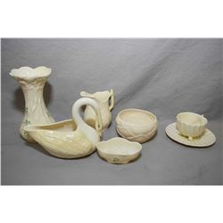 "Seven pieces of green and brown mark Belleek including a 6"" vase, swan cream and sugar, small shell"