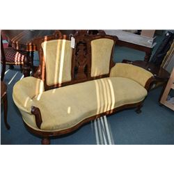 Antique Victorian large two seater settee with ornate carved and reupholstered in gold velvet uphols