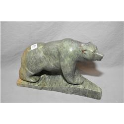 "Carved soapstone polar bear signed by artist on base, 10"" in length"