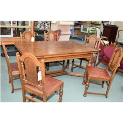 Refractory style oak draw leaf dining table with six chairs including one carver