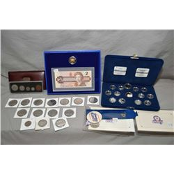 Selection of collectible Royal Canadian mint coins including boxed commemorative sterling silver Pro