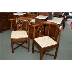 Pair of mid 20th century matching corner chairs with alternating turn and fretwork supports and upho