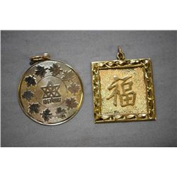 Two 14kt yellow gold pendants including double sided pendant with Chinese character and floral flip