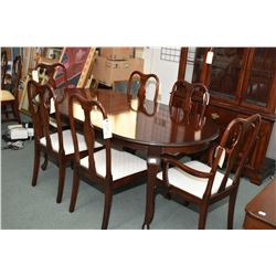 Eight piece modern dining suite including table with insert leaf, six chair including one carver and