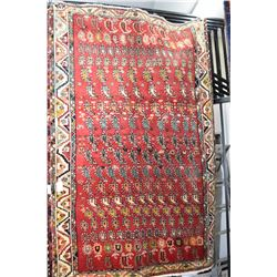 100% wool area rug with multiple border, overall geometric design in shades of red, orange, green an