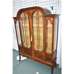 Antique matched grain mahogany two door display cabinet with delicate carved door decoration, inlaid