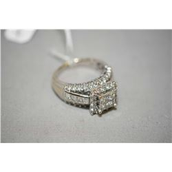 Ladies 14kt white gold and diamond ring set with four princess cut center diamonds weighing .80ct, f