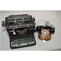 Vintage Underwood manual typerwriter and an antique copper rotary desk phone with flip up carry hand