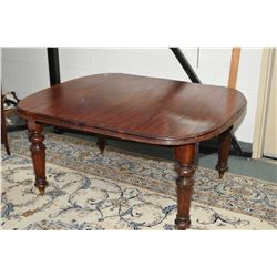 Victorian mahogany dining table with reeded support and porcelain castors